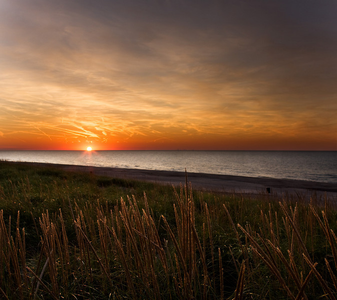 Sunset at Michigan City IN looking across Lake Michigan toward Chicago.
