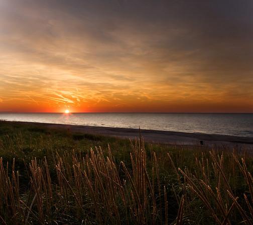 Sunset at Michigan City IN looking across Lake Michigan toward Chicago.