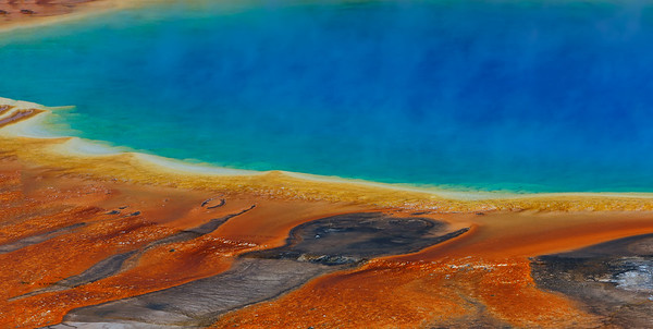 Warm and cool colors juxtaposed at Grand Prismatic Spring, Yellowstone National Park, Wyoming, USA.