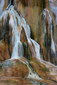 Travestine deposits from super-heated geyser, Mammoth Hot Springs, Yellowstone National Park, Wyoming, USA.