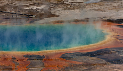 A boardwalk leads visitors to Grand Prismatic Spring, Yellowstone National Park, Wyoming, USA.