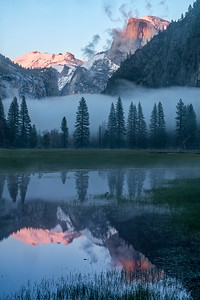 Alpenglow on Clouds Rest and Half Dome