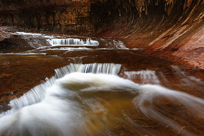North Creek cascades through the opening of the Subway, Zion National Park, Utah, USA.