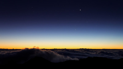 Many people go to watch the sunrise from the 10,023' summit of Haleakala...but really it's best about an hour before dawn. Both Venus and Mercury visible, and the windblown clouds breaking across the rift zone like a wave.  It's worth getting up early for...