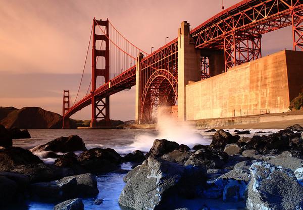 Warm sun setting on the Golden Gate Bridge.