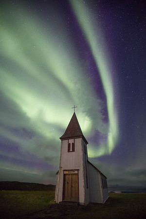 Hellnar church illuminated by the northern lights