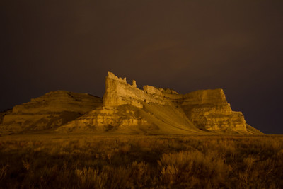 Scottsbluff National Monument is located outside of the towns of Scottsbluff and Gering Nebraska. It is located on the Oregon, Mormon, and California Trails and was one of the major landmarks on the way out west. This shot was taken on a cloudy evening. The illumination is provided by street lights from the local town.