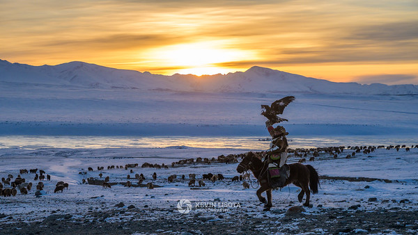 Eagle hunter rides at sunset in the Altai Mountains