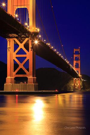 Golden Gate lights up the water below.