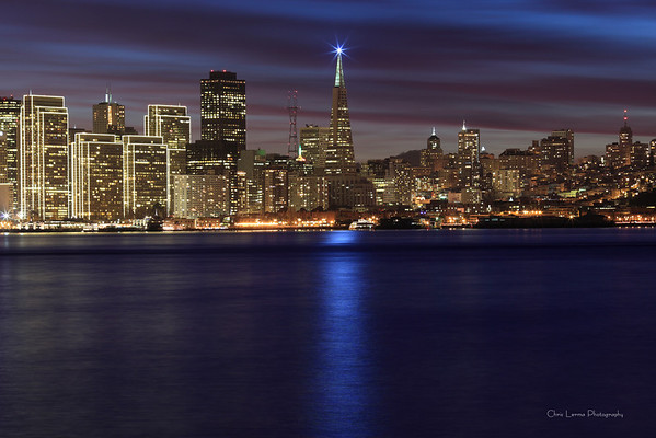 Star light of the Transamerican building shines upon the bay.