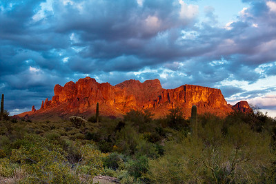 Cloudy Superstition Mountain at sunset