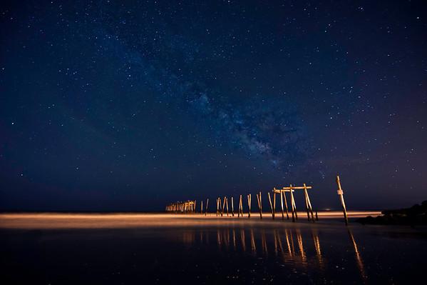 milk way galaxy over abandoned fishing pier in ocean city, nj