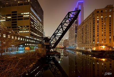 Kinzie Street Rail Bridge...  My take on the southern view of the Chicago river as seen from the Hubbard street Bridge.... This is an old rail car bridge that goes directly into the Sun-times building... Willits tower, the tallest building in Chicago, is also hidden from view by tonight's fog...