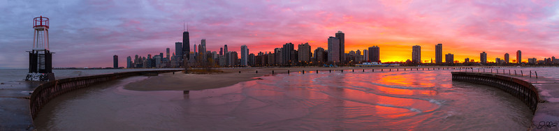 Hurricane Sandy Halloween Sunset in Chicago...  Over the past couple of days while hurricane Sandy has been demolishing the east coast, we have been getting some epic sunsets here in Chicago as a side effect. On this Halloween eve, we had one of the most spectacular sunsets I have ever witnessed here in Chicago. Even though I got drenched by an icy cold stray wave crashing up over the boardwalk, Im soo glad I was out there to capture this amazing colorful display that mother nature put on.