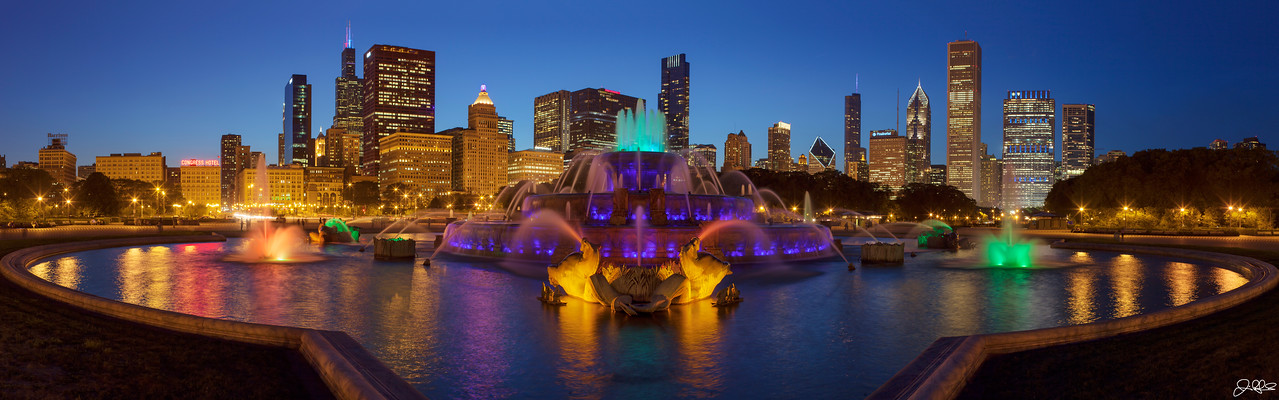 Buckingham Blue Hour Panoramic...<br /> <br /> Chicago's Buckingham fountain all lit up on this beautiful summer evening. Buckingham Fountain, of Chicago's famous land marks, is located in the center of Grant Park. Dedicated in 1927, the fountain was donated to the city by Kate Buckingham in memory of her brother, Clarence Buckingham and was constructed at a cost of $750,000. It is one of the largest fountains in the world and was built in a rococo wedding cake style. It was inspired by the Latona Fountain at the Palace of Versailles and is meant to allegorically represent Lake Michigan. It operates from April to October, with regular water shows and evening color-light shows.<br /> <br /> The original file of this image is 104 megapixels and has a native resolution of 18271 x 5712...