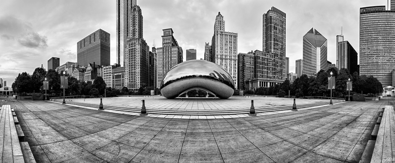 "Cloud Gate in B&W...<br /> <br /> Cloud Gate is a public sculpture crafted by Anish Kapoor and is the centerpiece of  Millennium Park in Chicago, Illinois. Completed in 2006, the sculpture is nicknamed ""The Bean"" because of its bean-like shape. The Bean is made up of 168 stainless steel plates welded together and has been highly polished so that their are no visible seams. It is 33 by 66 by 42 feet and weighs roughly 110 tons. Believed to have been inspired by liquid mercury, the sculpture's surface reflects and distorts the city's skyline at a number of different angles. On the underside is the ""omphalos"" (Greek for ""navel""), which is a concave chamber that warps and multiplies reflections similar to a fun house mirror. Even with its relatively brief history, ""The Bean"" has quickly become a top tourist destination and an iconic landmark to the city of Chicago."
