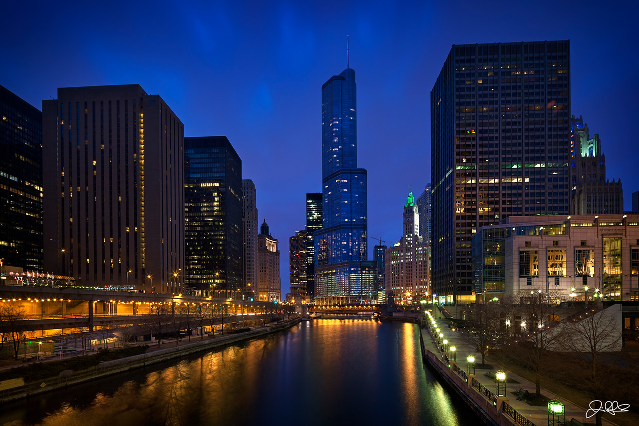 Main Branch...<br /> <br /> The main branch of the Chicago River is always pretty amazing at blue hour. On this Easter night, huge clouds rolled in and created just a hint of movement in the sky as the city started to glow with its colorful array of lights.