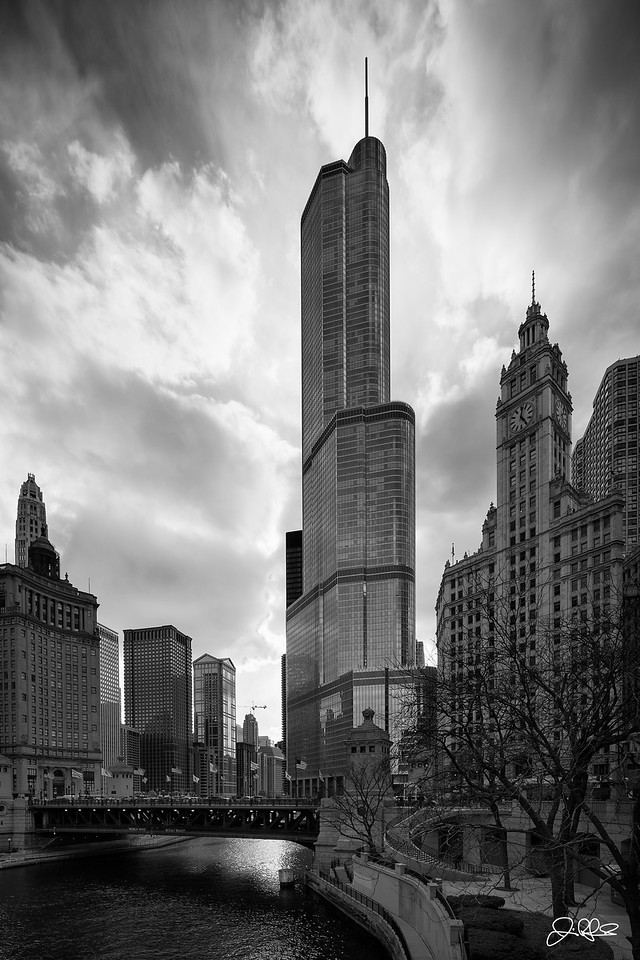 Trump Tower...<br /> <br /> As part of a project I am working on with Choose Chicago, they recently asked me for a full building photograph of Trump Tower. I had to dig a bit into the archives for this one, but I found it. This was taken on an ice cold day in April while I was testing Canon's 17mm tilt shift lens. Temps where in the single digits and I didn't have any gloves with me. I remember being soo cold that I had to take refuge in Starbucks for about 20 minutes or so to avoid frostbite and let my hands warm up. Ironically, 2 days later it was warm enough to wear shorts, as is typical with Chicago springtime weather!!!