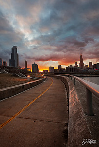 Into the Light...  Its still pretty cold out, but we had some dramatic spring type clouds hanging out over the city today. At first I almost headed home, but I decided to wait it out for a bit and was treated to this colorful display on the lake front bike path near the Shedd Aquarium.