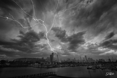BOOM!!!....  A huge lighting bolt strikes the antennae of the Willis Tower on a stormy afternoon in Chicago. I had just left an art presentation Athena Restaurant Chicago Greektown for Choose Chicago when I noticed some decent cloud structure forming overhead. I already had my camera with me so I headed out to Northerly Island to check out the storm rolling in. As you can see, mother nature put on quite the show!!!