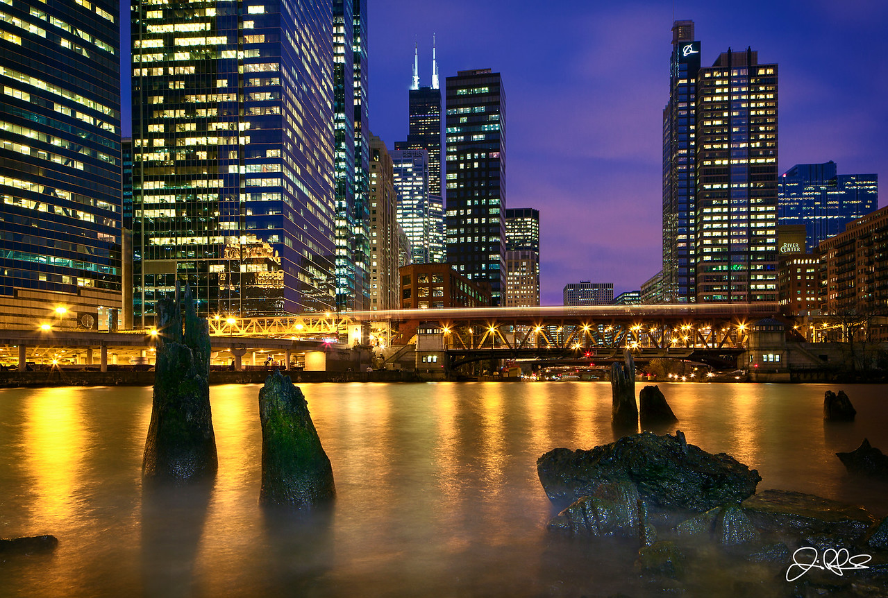 Chicago River Blue Hour...<br /> <br /> Waves crash along the shore of the Chicago River. Winter is definitely here and today was the first day below freezing that we have had this fall. Even with the chilly weather, the storm clouds over the city enticed me to head out and shoot. I hunkered down and tried to keep warm as I waited patiently for each boat to pass and create some mystic waves. After a long day of shooting in the studio, it was nice to get out and clear my head, with just the wind, passing trains, and other sounds of the city in the background.
