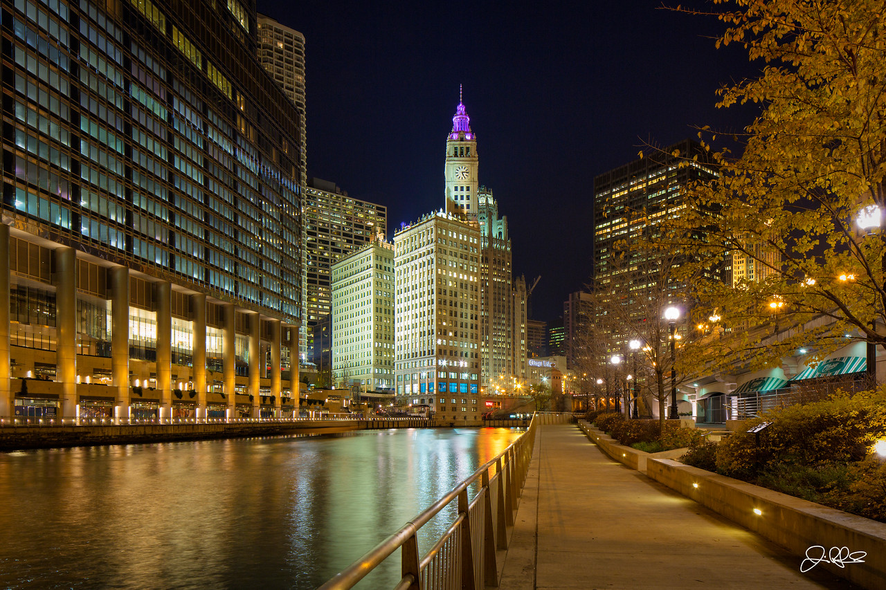 River Night...<br /> <br /> With the magnificent Trump Tower on the left and the classic architecture of the Wrigley Building in the distance, the riverwalk is a great place to take a walk and enjoy Chicago's scenery. Located just next to Wacker drive along the main branch of the Chicago River, the riverwalk is home to a number of restaurants, cozy parks, and Official Chicago Architecture Foundation River Cruise. Be sure to check it out on your next visit to Chicago!
