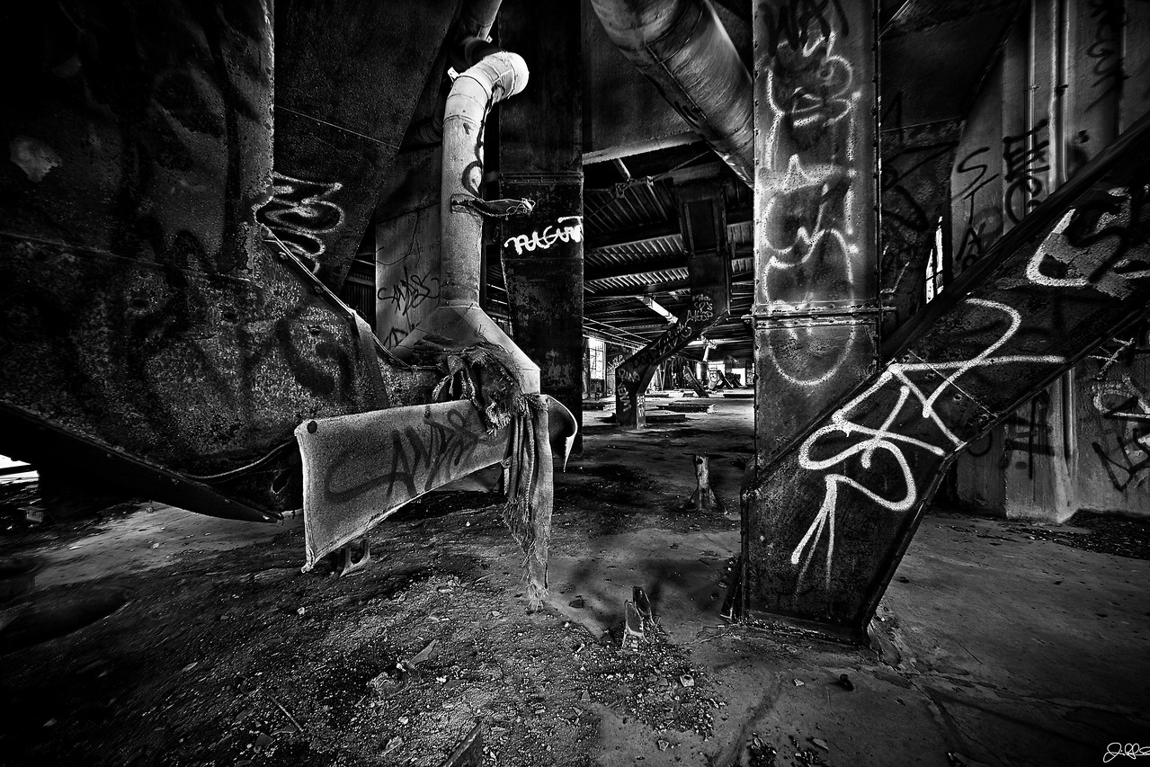 """Damen Silo's Upper Level Main Room...<br /> <br /> The upper level of the Damen Silo's is lined with intricate duct work, graffiti, and decay that only decades of abandonment can provide. Its a photographers paradise that can only be reached by making a daring climb up some """"not so safe"""" stairs that have now been removed..."""