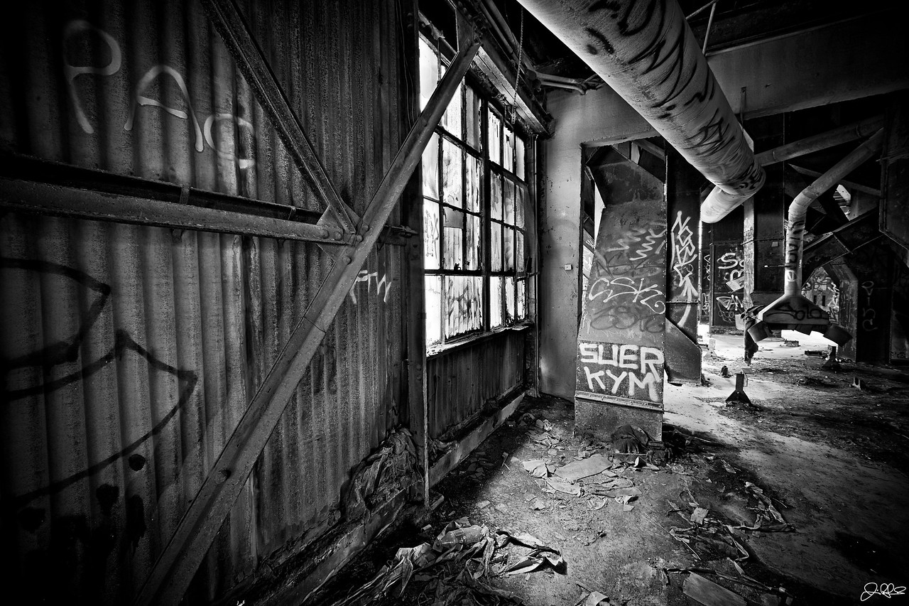 Upstairs in the Abandoned Factory... <br /> <br /> If your brave enough to make the dicey 15 story climb up a rickety steel staircase to the top, you will be rewarded with what I would call Urban Decay Heaven!!!! The light coming through this window was soo perfect in this HDR paradise that I just couldnt resist getting this shot....<br /> <br /> BTW, only 2 out of the 4 of us made the climb... It was really gnarly but soo worth it!!!!