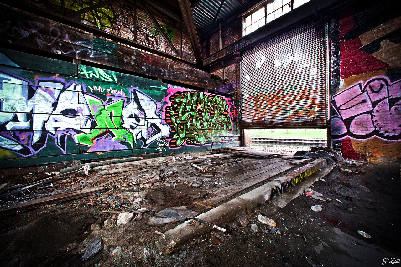 Abandoned Warehouse Loading Dock....<br /> <br /> This loading bay door in this abandoned warehouse is fixed at this position. Years of corrosion and neglect have seized the gears....
