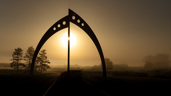 Borken Symmetry Scupture Under Foggy Sunrise