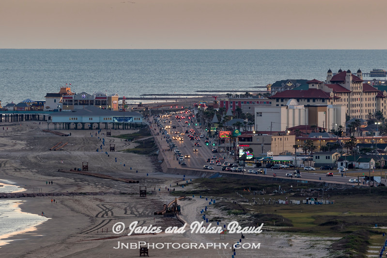 View of Galveston Seawall Driver and Pleasure Pier from Galveston East Beach Palisades Palms tower.