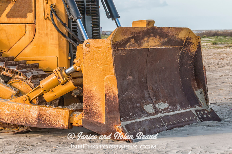 Caterpillar tractor working on Galveston East Beach.