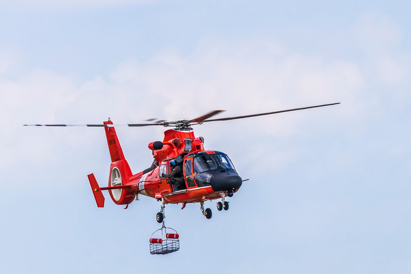 US Coast Guard MH-65 Dolphin Helicopter demonstrating rescue procedures at 2019 Wings Over Houston at Ellington Field in Houston, Texas.