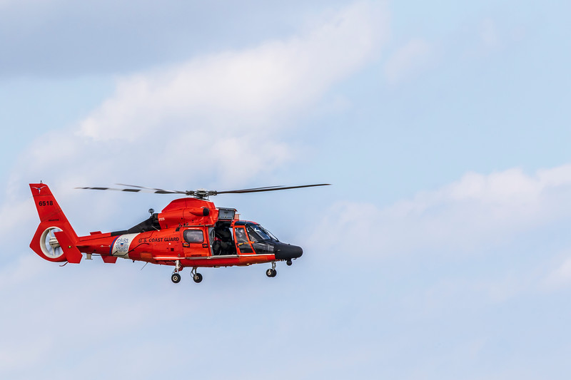 US Coast Guard MH-65 Dolphin Helicopter search and rescue demonstration at 2019 Wings Over Houston airshow, Houston, Texas.