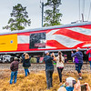 George H W Bush Union Pacific 4141 funeral with crowd celebrating as train came to Hardin Store Road railroad crossing in Magnolia (near Tomball) Texas. Rainy day did not deter the throngs waiting to see the funeral train and honor President Bush.