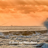 Fishing amid dramatic wind and waves at sunrise on Galveston East Beach.