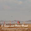 Beach visitors walking in the wind on Galveston East Beach.