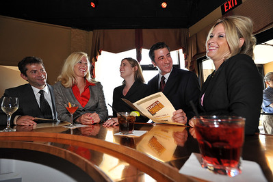 Lawyers from The Health Partners in Southfield at a local watering hole, from left are, Carey Kalmowitz, Abby Pendleton, Jessica Gustafson, Rob Iwrey, and Adrienne Dresevic.  At the Health Law Partners there's an enthusiastic, non-conformist, relaxed atmosphere.  (Photo by Mark Bialek)