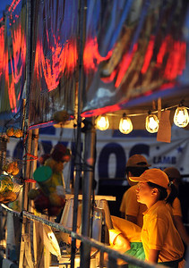 "A food booth reflects the setting sun during ""A Taste of Ann Arbor"" in downtown Ann Arbor, MI.  (Photo by Mark Bialek)"