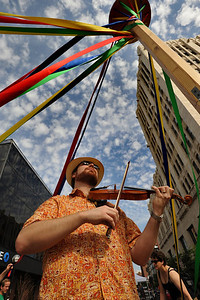 A violinist plays on Main Street in Ann Arbor, MI.  (Photo by Mark Bialek)