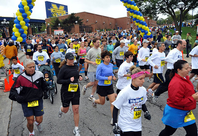 Runners begin the 5k run in front of Michigan Stadium during the third annual Big House Big Hearts event on Sunday, Oct 4, 2009.  More than 10,000 runners and walkers participated.  (Mark Bialek for AnnArbor.com)