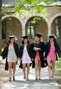 From left, Alexis Marino, Gem Manalo, Alexia Tamer, and Becca Kendis walk through the University of Michigan's Law Quad on April 29, 2012 after getting their undergraduate degrees the day before.  They were walking around campus to all the familiar spots getting keepsake photos of themselves.