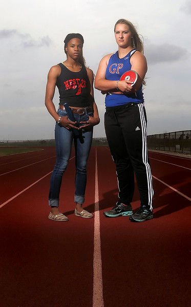 West Oso Bears A'keyla Mitchell and Gregory-Portland Wildcats Haley Teel