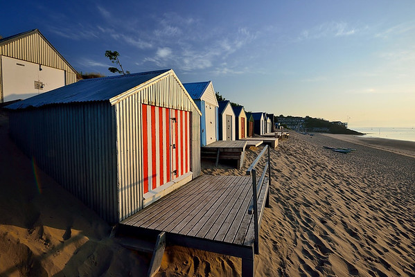 Beach huts at sunrise,Abersoch. Visit Wales