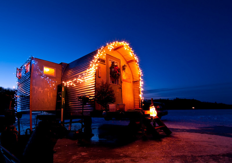Ouellette Ice Shack, lit up at twilight, 3, Sabattus Pond, Maine.