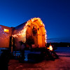 Ouellette Ice Shack, lit up at twilight, 3, Sabattus Pond, Maine.