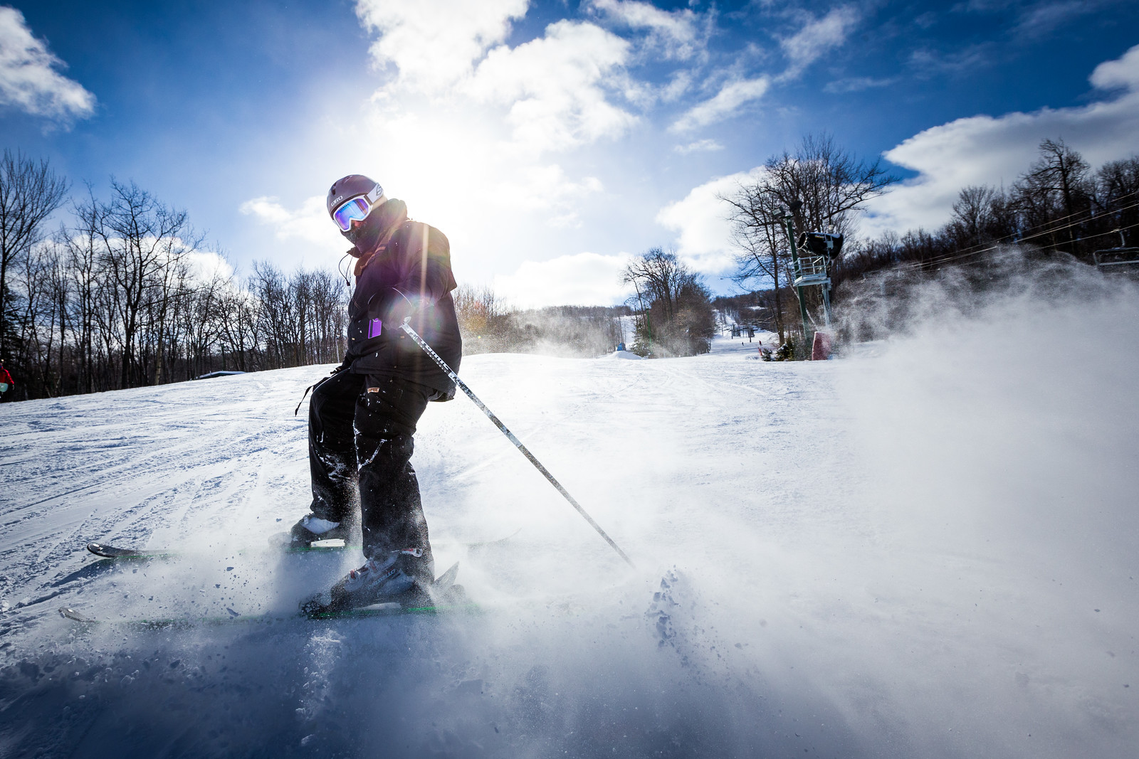 A person skiing during a sunny day.