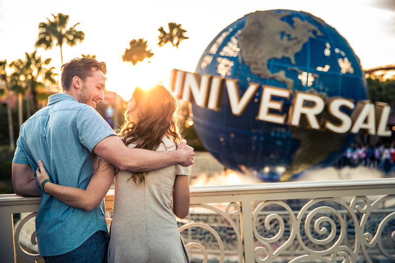 A young couple standing in front of the Universal Studio.