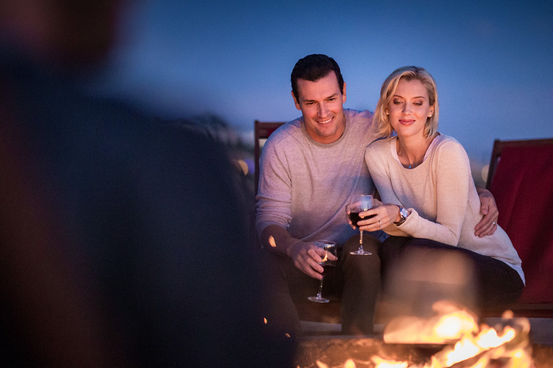 A man and woman enjoying the warm fire.