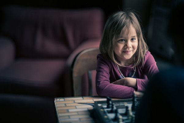 Picture of young girl playing chess.